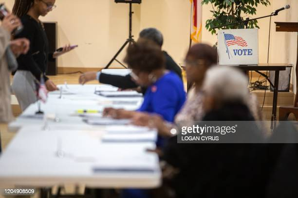 Poll worker prepares a paper ballot at East Stonewall AME Church during the North Carolina primary on Super Tuesday in Charlotte, North Carolina on...