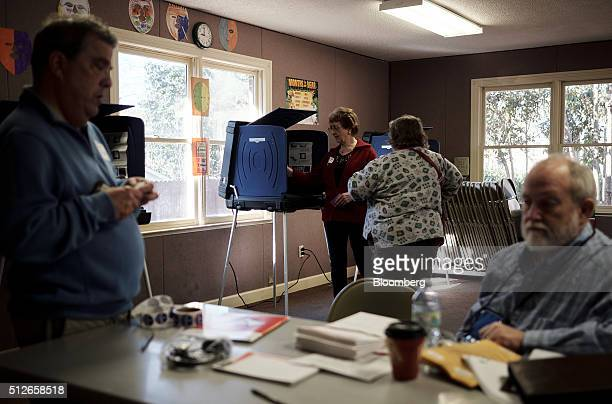 A poll worker sets up a machine for a resident to vote in the South Carolina Democratic presidential primary election at a polling station at Sims...