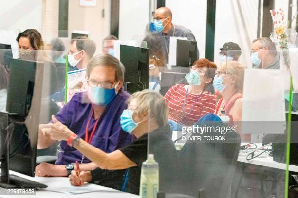 Poll workers count ballots inside the Maricopa County Election Department in Phoenix, Arizona on November 5, 2020 - Former vice president Joe Biden,...