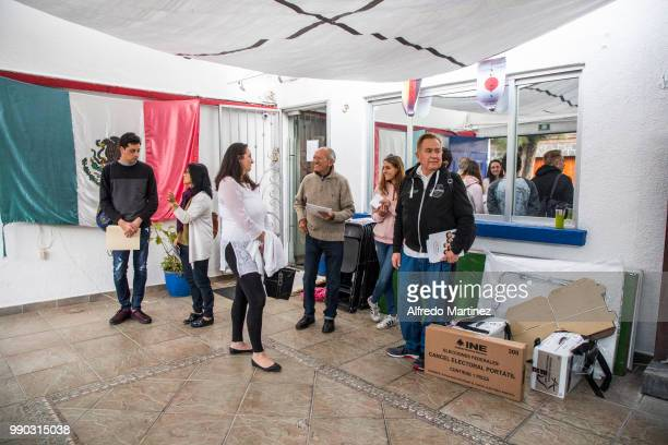 Poll workers get ready to prepare the vote polling station located inside Museo Italo calvino school during the 2018 Presidential Elections in Mexico...
