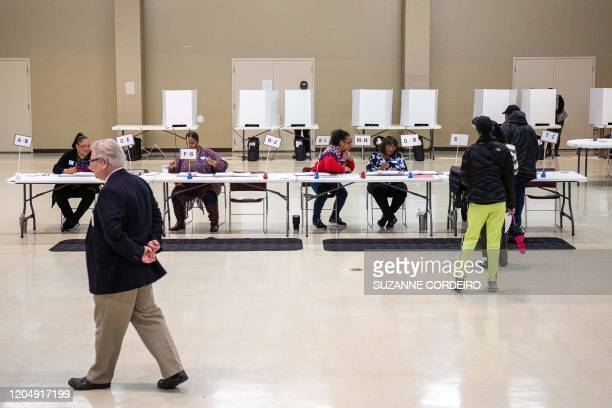 Poll workers prepare paper ballots at the Oasis Shriners Temple polling station during the North Carolina primary on Super Tuesday in Charlotte,...