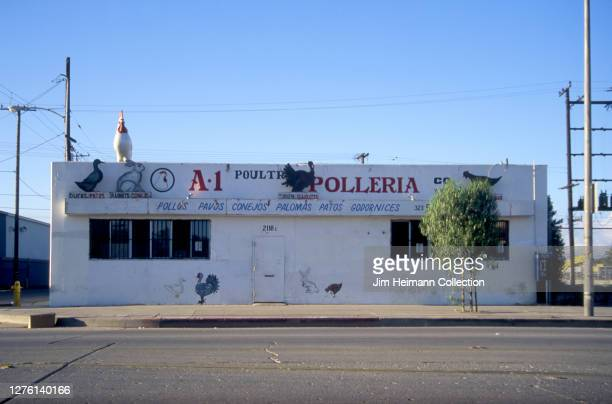 Polleria at 2118 East Florence Avenue in Los Angeles, California has a giant chicken perched on the roof, 2000.