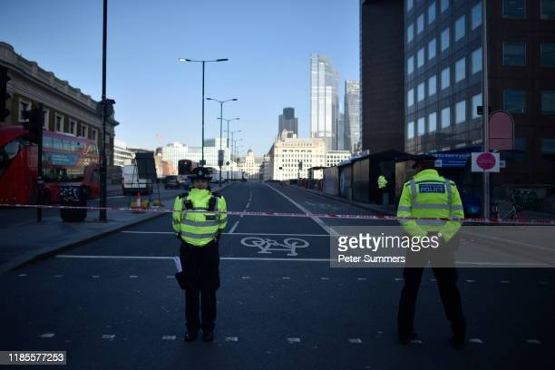 Pollice officers guard the scene of yesterday's London Bridge stabbing attack as investigations continue on November 30 2019 in London England A man...