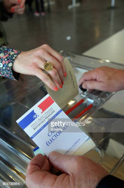 Polling Booth in France Hand dropping ballot France