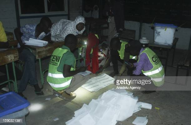 Polling clerks count ballots at the Lobbit School after voting for presidential and parliamentary elections in Maradi, Niger on December 27, 2020.