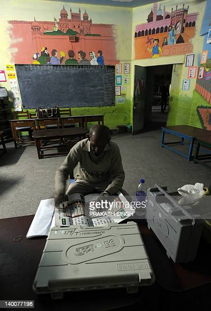 Polling officer sets up a polling booth at a school in Ghaziabad, Uttar Pradesh on February 27, 2012. The sixth phase of assembly polls will be held...