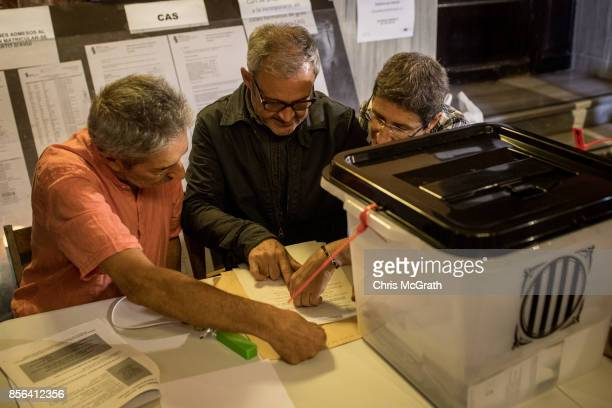 Polling officers are seen ahead of the start of vote counting at the Escola Industrial of Barcelona school polling station as the Catalan government...