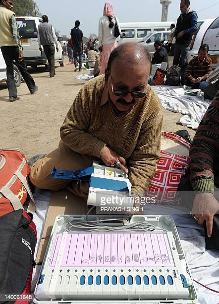 Polling officers check electronic voting machines at an EVM distribution centre in Ghaziabad Uttar Pradesh on February 27 2012 The sixth phase of...
