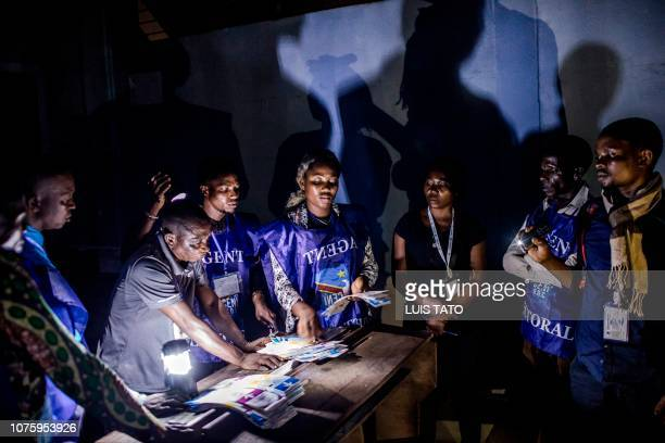 A polling official counts votes in a school in Kinshasa on December 30 during Democratic Republic of Congo's general elections After two years of...