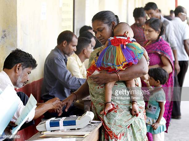 A polling official putting ink stain on finger of a voter at DAV School polling booth for the 3rd Phase of Bihar Assembly Election on October 28 2015...