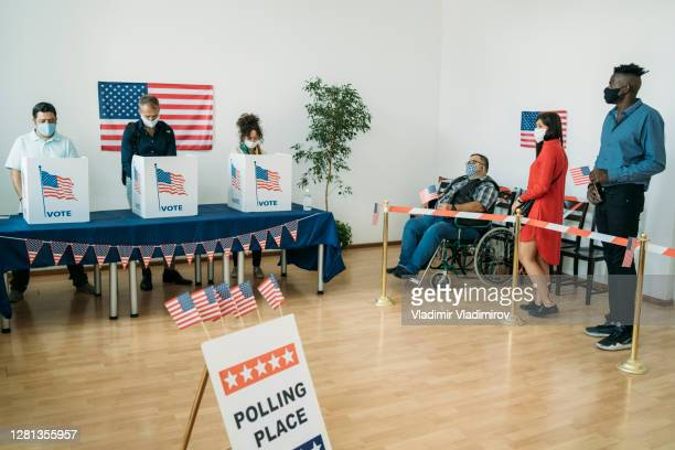 polling place in time of pandemic - presidential candidate stock pictures, royalty-free photos & images