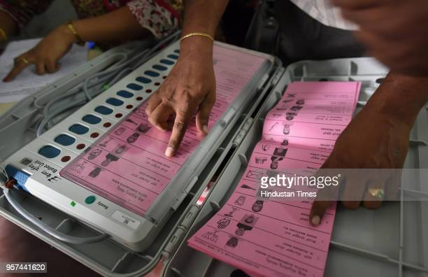 A polling staff tallies the candidates names on the Electronic Voting Machines before leaving for their respective booths at the mustering centre in...
