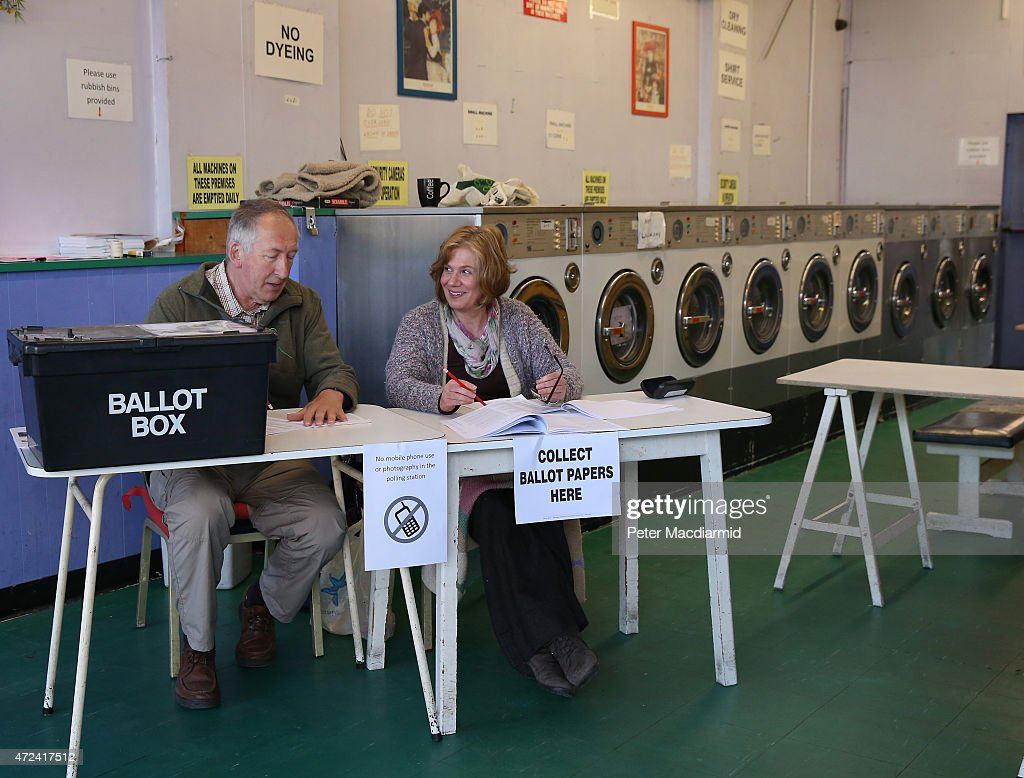 A polling station has been installed in a launderette on May 7, 2015 in Oxford, England. The United Kingdom has gone to the polls to vote for a new government in one of the most closely fought General Elections in recent history. With the result too close to call it is anticipated that there will be no overall clear majority winner and a coalition government will have to be formed once again.