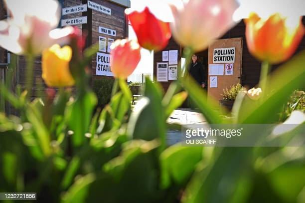 Polling station is seen through the flowers set up in a garden allotment in Hartlepool to cast a vote in local elections on May 6, 2021. - Britain...