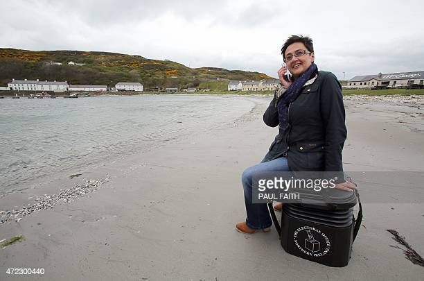 Polling station manager Teresa McCurdy arrives on Rathlin Island off the north east coast of Northern Ireland on May 5 carrying a ballot box in which...