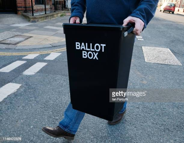 A polling station official carries a ballot box to a polling station during local elections on May 02 2019 in Saltburn By The Sea United Kingdom The...