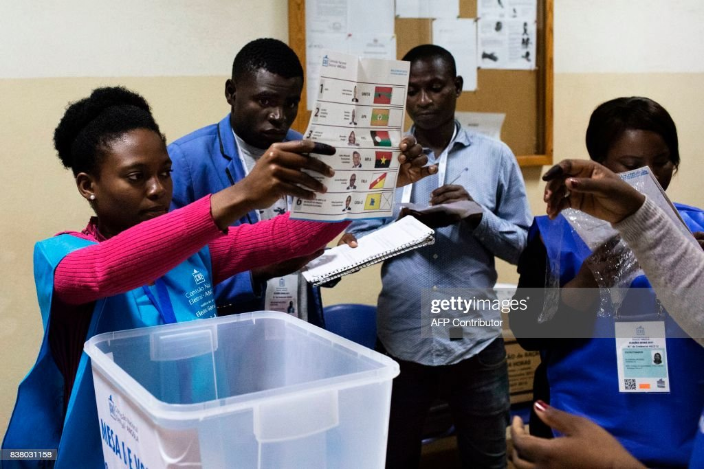 A polling station official shows a ballot during the counting of votes at the end of the general election in Luanda, on August 23, 2017. Angolans voted on August 23 in an election marking the end of President Jose Eduardo dos Santos's 38-year reign, with his MPLA party set to retain power despite an economic crisis. /