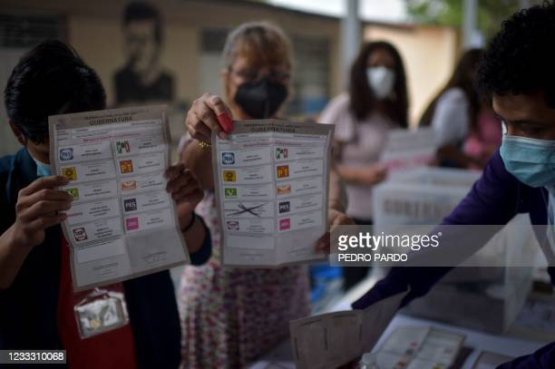 Polling station officials count the votes for governor of Guerrero in Petaquillas, Mexico, on June 6, 2021. - Mexicans voted on Sunday in elections...