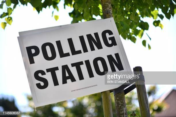 A polling station sign for the European Parliament elections is seen in Croydon south London on May 23 2019 Voting got under way in Britain early on...