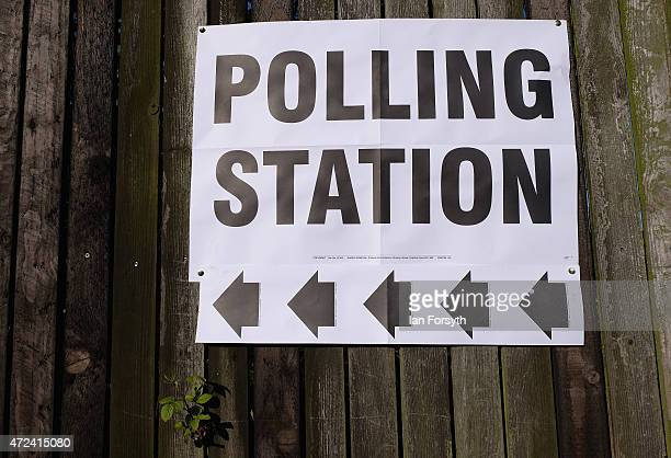 A polling station sign is attached to a fence outside a polling centre situated in a scout hut on May 7 2015 in Eston England The nation goes to the...