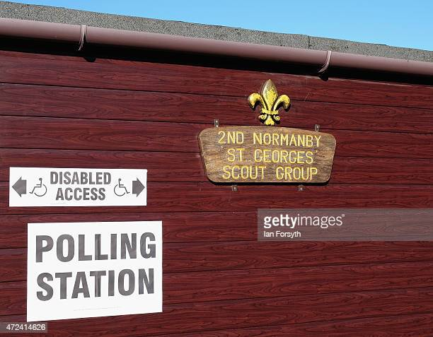 A polling Station sign is attached to a wall at a polling station situated in a scout hut on May 7 2015 in Eston England The nation goes to the polls...