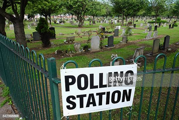 A polling station sign is attached to railings next to a cemetery in Redcar as voters head to the polls to cast their vote on the EU Referendum on...