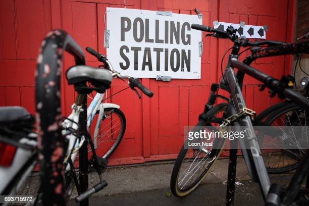 Polling station sign is seen among the bicycles outside a former fire station on June 8, 2017 in London, United Kingdom. Polling stations have opened...