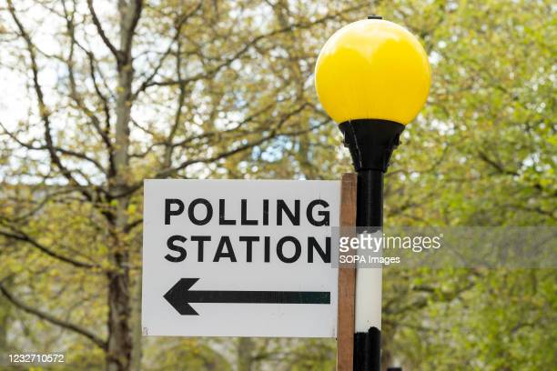Polling station sign seen at Belisha beacon in Westminster ahead of the 2021 London mayoral election on the 6th May.