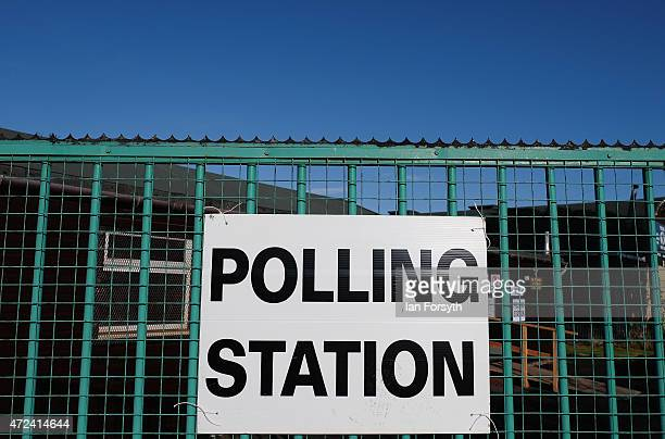Polling Station signs are attached to a fence at a polling station situated in a scout hut on May 7 2015 in Eston England The nation goes to the...