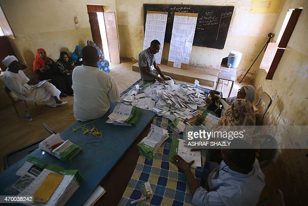 Polling station staff members count votes at a polling station in the Sudanese capital Khartoum on April 17 2015 The African Union's Election...