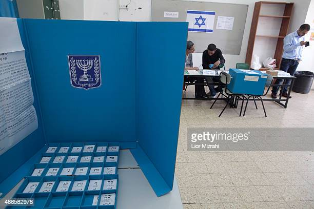 Polling station staff wait for voters on election day on March 17 2015 in Arab Israeli village of Abu Gush Israel Israel's general election voting...