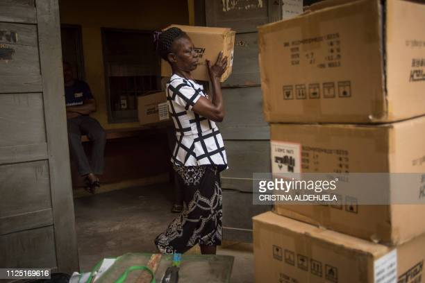 A polling station worker carries electoral materials no sensitive at Aba South Local Government to send them back to the Independent Nigerian...