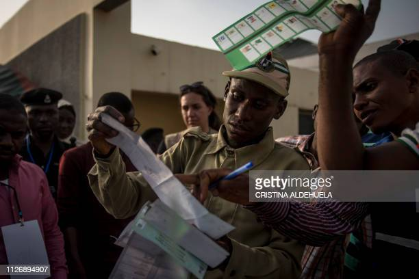 Polling station workers count the votes at Kaduna Capital School in Kaduna on February 23 2019 Nigeria began counting votes in presidential elections...