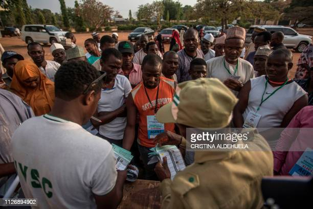Polling station workers count votes at Kaduna Capital School in Kaduna on February 23 2019 Nigeria began counting votes in presidential elections...
