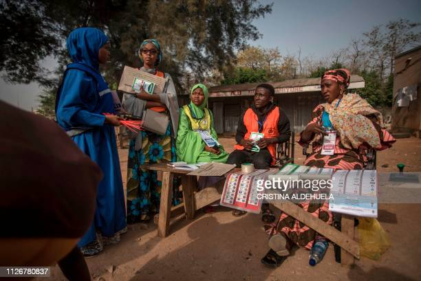 Polling station workers wait to open a polling station in Kaduna on February 23 which was scheduled to open at 0800 as Nigeria votes to elect its new...
