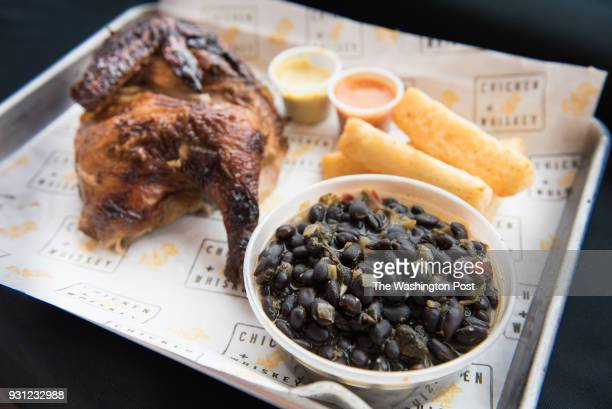 Pollo A La Brasa South American rotisserie chicken with yuca fries black beans at Chicken Whiskey in Washington DC on March 8 2018