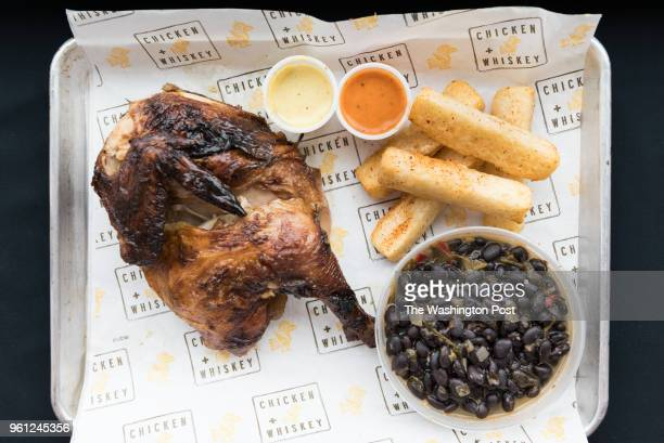 Pollo A La Brasa - South American rotisserie chicken with yuca fries & black beans at Chicken Whiskey in Washington, DC on March 8, 2018.