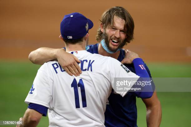 Pollock and Clayton Kershaw of the Los Angeles Dodgers celebrate after defeating the Tampa Bay Rays 3-1 in Game Six to win the 2020 MLB World Series...