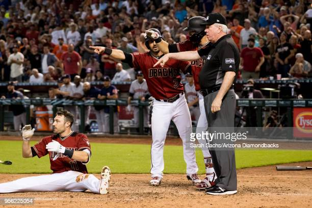 J Pollock Daniel Descalso and Steven Souza Jr #28 of the Arizona Diamondbacks point to the third base umpire to confirm an interference call against...