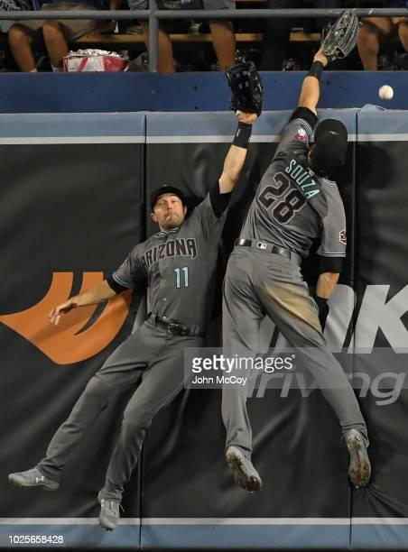 J Pollock of the Arizona Diamondbacks and Steven Souza Jr #28 can not get this home run ball hit by Enrique Hernandez of the Los Angeles Dodgers in...