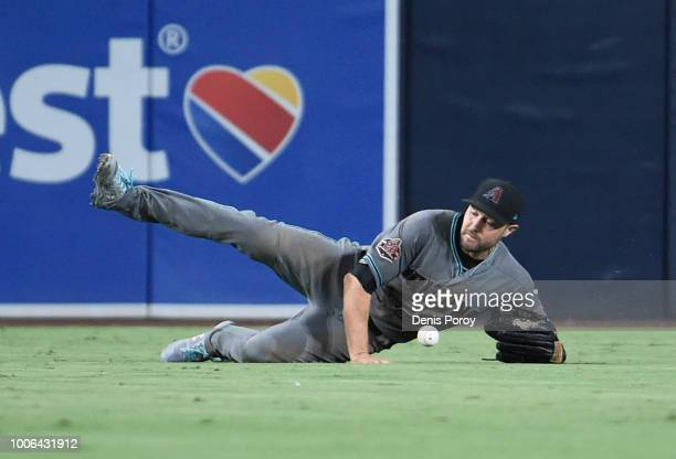 J Pollock of the Arizona Diamondbacks can't make the catch on a single hit by Travis Jankowski of the San Diego Padres during the sixth inning of a...