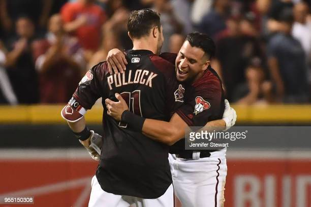 Pollock of the Arizona Diamondbacks celebrates a walk off single with David Peralta during the MLB game against the Houston Astros at Chase Field on...