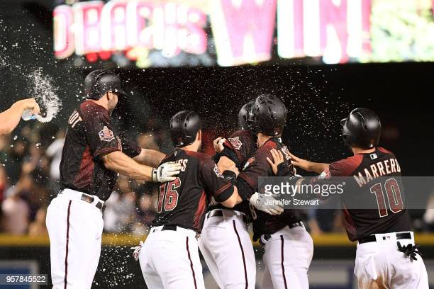 J Pollock of the Arizona Diamondbacks celebrates a walk off single with teammates during the MLB game against the Houston Astros at Chase Field on...