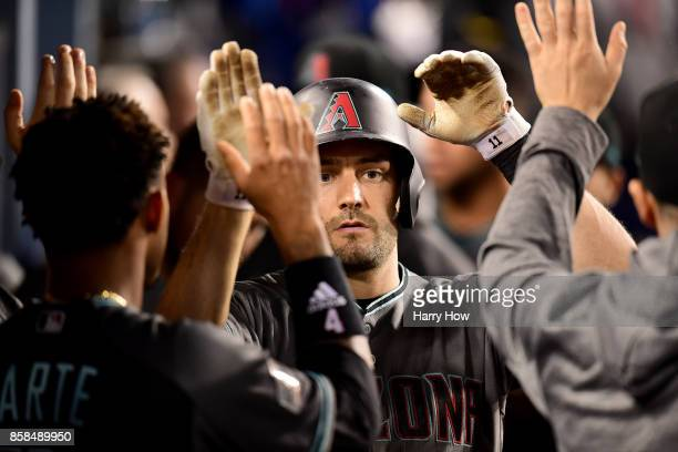 J Pollock of the Arizona Diamondbacks celebrates after hitting a solo home run in the third inning against the Los Angeles Dodgers in game one of the...