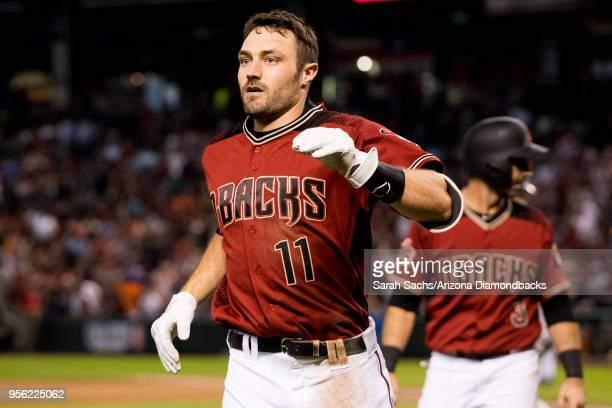 J Pollock of the Arizona Diamondbacks celebrates after scoring on an interference call against Alex Bregman of the Houston Astros in the sixth inning...