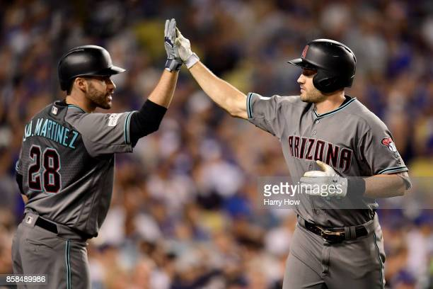 J Pollock of the Arizona Diamondbacks celebrates with JD Martinez after Pollock hits a solo home run in the third inning against the Los Angeles...