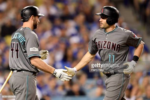 J Pollock of the Arizona Diamondbacks celebrates with Paul Goldschmidt after Pollock hits a solo home run in the third inning against the Los Angeles...