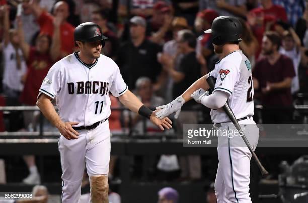 Pollock of the Arizona Diamondbacks celebrates with teammate Brandon Drury after scoring a run in the eighth inning against the Colorado Rockies...