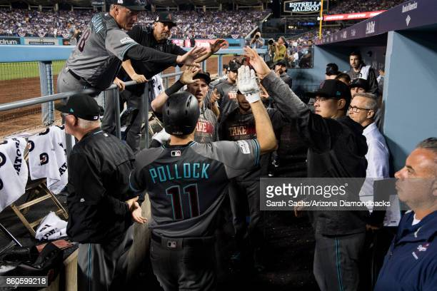 J Pollock of the Arizona Diamondbacks celebrates with teammates after hitting a home run during game one of the National League Division Series...