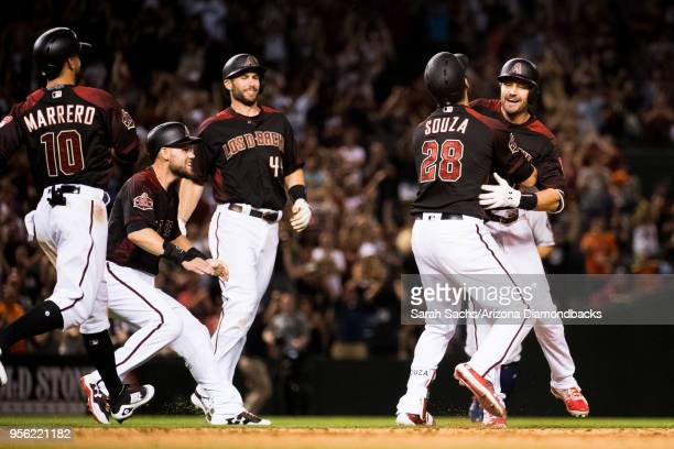 J Pollock of the Arizona Diamondbacks celebrates with teammates after hitting a walkoff RBI single during a game against the Houston Astros at Chase...